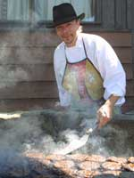 Chef Chris cooks up some tastey Black Angus burgers.