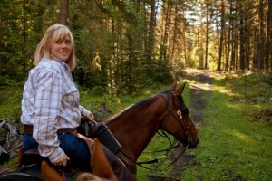 Cheryl & Dakota lead the ride at Tod Mountain Ranch