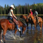 wranglers on horses at free rein guest ranch