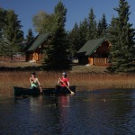 womeen canoeing at free rein guest ranch