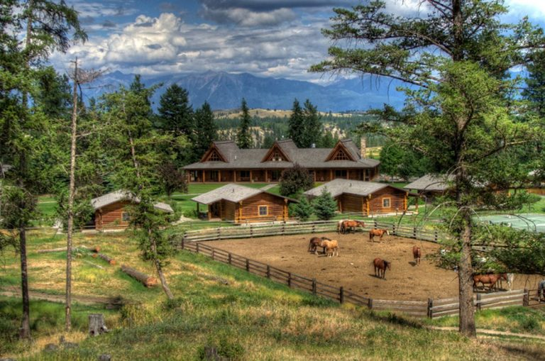 horses on ranch with beautiful cabins and mountains
