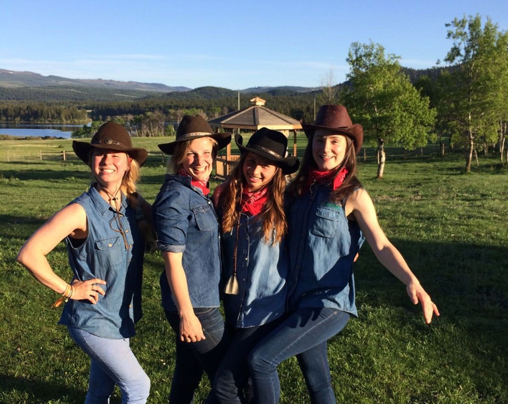 girls dressed as ranchers smiling and posing