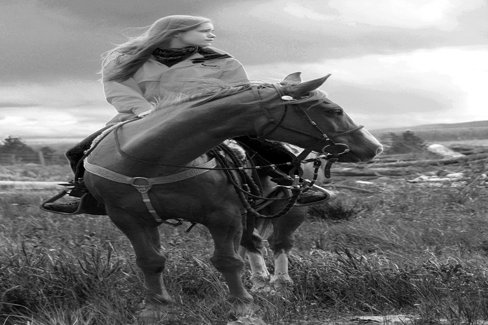 woman on horse black and white